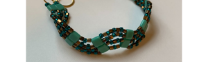 Handmade intricate beaded bracelet in teal and gold